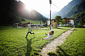 Girl playing on the zip line, outdoor area of a Hotel, Pflersch, Gossensass, South Tyrol, Italy