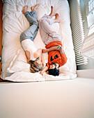 Couple on the bed of a three star hotelroom, Zeeburg, Amsterdam, Netherlands