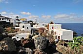 Lava and houses, Island of Stromboli, Aeolian Islands, Sicily, Italy