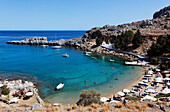 People on the beach at Agios Pavlos Bay, Lindos, Rhodes, Dodecanese Islands, Greece, Europe