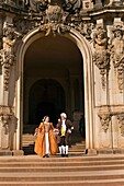 A procession of the Royal Court of August the Strong people in historical costume at the Dresden Zwinger, Dresden, Saxony, Germany