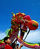 Asia, Asian, boy, dragon, festival, outdoors, parad. Asia, Asian, Boy, Dragon, Festival, Holiday, Landmark, Outdoors, Parade, People, Singapore, Asia, Tourism, Travel, Vacation, Wor