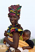 Africa, African, asleep, Banjul, family, Gambia, he. Africa, African, Asleep, Banjul, Family, Gambia, Africa, Headdress, Holiday, Landmark, Mother, Outdoors, Papoose, People, Sleep