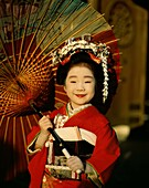 Asia, Asian, child, costume, cultural, culture, gei. Asia, Asian, Child, Costume, Cultural, Culture, Geisha, Girl, Hold, Holding, Holiday, Indoors, Japan, Japanese, Kimono, Landmark