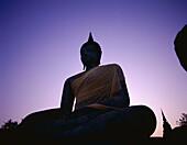 Dawn, Seated Buddha, Silouhette, Sukhothai, Thailan. Asia, Buddha, Dawn, Heritage, Holiday, Landmark, Seated, Silouhette, Sukhothai, Thailand, Tourism, Travel, Unesco, Vacation, Wat