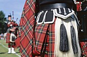 Bagpiper, Detail of Kilt, Highland Games, Highlands. Bagpiper, Detail, Highland games, Highlands, Holiday, Kilt, Landmark, Scotland, United Kingdom, Great Britain, Sporran, Tourism