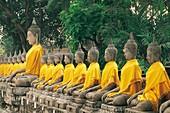 BUDDHAS WRAPPED WITH SILK ROBES, WAT YAI CHAI MONGKHON, AYUTHAYA, THAILAND