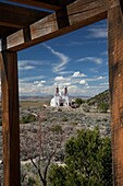 San Luis, Colorado - The Chapel of All Saints on a hill above town  The chapel is at the end of a trail with sculptures showing the Stations of the Cross