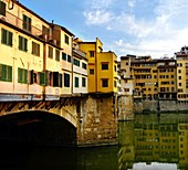 Pontevecchio bridge over the Arno river with details of the back of the shops held by wooden rafters Florence Italy