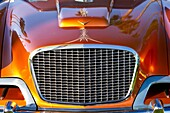 Close-up of sparkling grille and chrome on a vintage motorcar