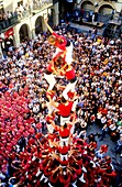 Colla Joves Xiquets de Valls  ´Castellers´ building human tower, a Catalan tradition  Plaça del Blat Valls  Tarragona province, Catalonia, Spain