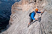 Elijah Weber climbing the Giovanni Lipella via ferrata on Tofana De Rozes in the Dolomite Mountains near the city of Cortina in northern Italy