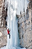 Man ice climbing a route called The Boy Scout which is rated WI, 4 and located in Lamoille Canyon at The Ruby Mountains in northeastern Nevada