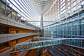 A wide-angle interior view captures the spacious 60-meter high atrium's laminated-glass and steel structure in the hull-shaped Glass Building, the main entrance hall for the Tokyo International Forum (Japan's largest conference, art, and congress ce [...]
