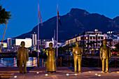 South Africa, Western Cape Province, Cape Town, Victoria & Alfred Waterfront pier, Nobel Square, statues of the nobel prizes Albert Luthuli (1960), Desmond Tutu (1984), Frederik Willem de Klerk (1993) and Nelson Mandela (1993)