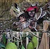 Baby girl with doll as symbol of Santo Nino figur, Ati Atihan festival, Ibaja, Aklan, Panay Island, Asiay, Ibajay, province Aklan, Visayas, Philippines