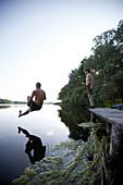 Man jumping into lake Goldensee, Klein Thurow, Roggendorf, Mecklenburg-Western Pomerania, Germany