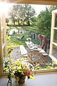 Man setting a table in a garden, Klein Thurow, Roggendorf, Mecklenburg-Western Pomerania, Germany