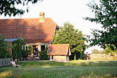 House and garden in the evening, Klein Thurow, Roggendorf, Mecklenburg-Western Pomerania, Germany