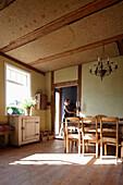 Woman entering house, Klein Thurow, Roggendorf, Mecklenburg-Western Pomerania, Germany