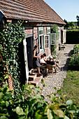 Family in a garden, Klein Thurow, Roggendorf, Mecklenburg-Western Pomerania, Germany