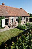 Family at dinner in a garden, Klein Thurow, Roggendorf, Mecklenburg-Western Pomerania, Germany