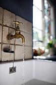 Water tap over a sink, Klein Thurow, Roggendorf, Mecklenburg-Western Pomerania, Germany