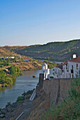Houses above Rio Guadiana river, Mertola, Alentejo, north of the Algarve, Portugal, Europe