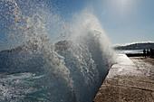 Breaking wave at the seaside promenade, Paseo del Peine del Viento, seafront, San Sebastian, Donostia, Camino de la Costa, Camino del Norte, coastal route, Way of St. James, Camino de Santiago, pilgrims way, province of Guipuzcoa, Basque Country, Euskadi,