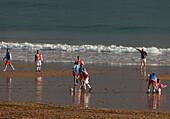 Football, training in the tidal zone, Playa El Sardinero, beach, sea, Atlantikc Ocean, Santander, Camino de la Costa, Coastal route, Camino del Norte, Way of Saint James, Camino de Santiago, pilgrims way, province of Cantabria, Cantabria, Northern Spain,