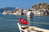 Boat with turkish flag, sarcophagus, Simena, Kalekoy, lycian coast, Mediterranean Sea, Turkey
