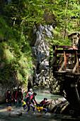 People crossing a stream, Salzburger Land, Salzburg, Austria, Europe