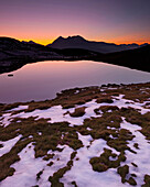 Patches of old snow on the shore of lake Salfains See, Evening light, Rosskogel, Tyrol, Austria