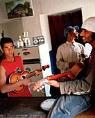 Father, sun and cousin playing music at Casa Ramiro, Cha das Caldeiras, Island of Fogo, Ilhas do Sotavento, Republic of Cape Verde, Africa