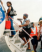 Passengers boarding a TACV flight to Boa Vista, Sal, Ilhas de Barlavento, Republic of Cape Verde, Africa