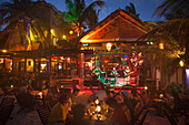 People sitting outside listening to a band playing live music at the Fusion beach bar and restaurant, Playa del Carmen, Riviera Maya, Quintana Roo, Mexico