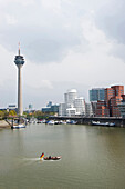 Boat at Media Harbour, television tower and buildings,  Duesseldorf, North Rhine-Westphalia, Germany, Europe
