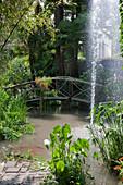 Bridge across a pond with fountain at Andre Hellers' Garden, Giardino Botanico, Gardone Riviera, Lake Garda, Lombardy, Italy, Europe