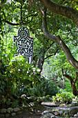 A Keith Haring sculpture at Andre Hellers' Garden, Giardino Botanico, Gardone Riviera, Lake Garda, Lombardy, Italy, Europe