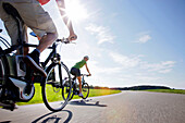 Young woman and young man on an e-bike, Lake Starnberg, Upper Bavaria, Germany
