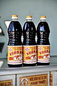 Bottles of vietnamese fish sauce, Mui Ne fishing village, Vietnam