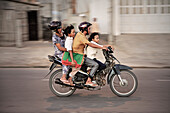 Vietnamese family riding on a motorbike, Mui Ne, Vietnam