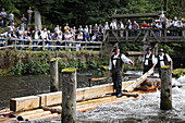 Men in traditional costumes on a raft, Timber rafting festival, Altensteig, River Nagold, Northern Black Forest, Baden Wurttemberg, Germany, Europe