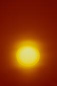LARGE SUN ON CLEAR ORANGE SKY