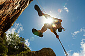 Man descending on abseil rope