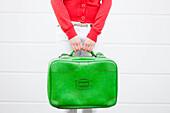 Girl holding suitcase. Girl holding suitcase