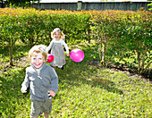 Kids running with pink balloons. Kids running with pink balloons