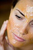 young woman with chocolate_mask closeup