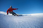 Skier turning on piste. Skier turning on piste.