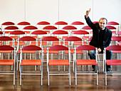 businessman alone raising hand